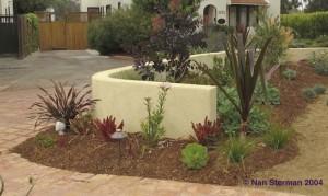 Mulch garden beds to keep them moist