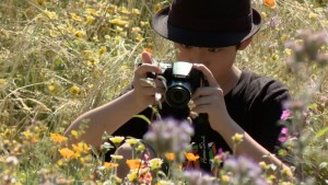 As any good scientist would do, this young man is documenting the pollinators he observes in the pollinator garden at the Natural History Museum of LA County