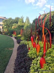Dancing glass flames liven up this garden walkway. Gardens